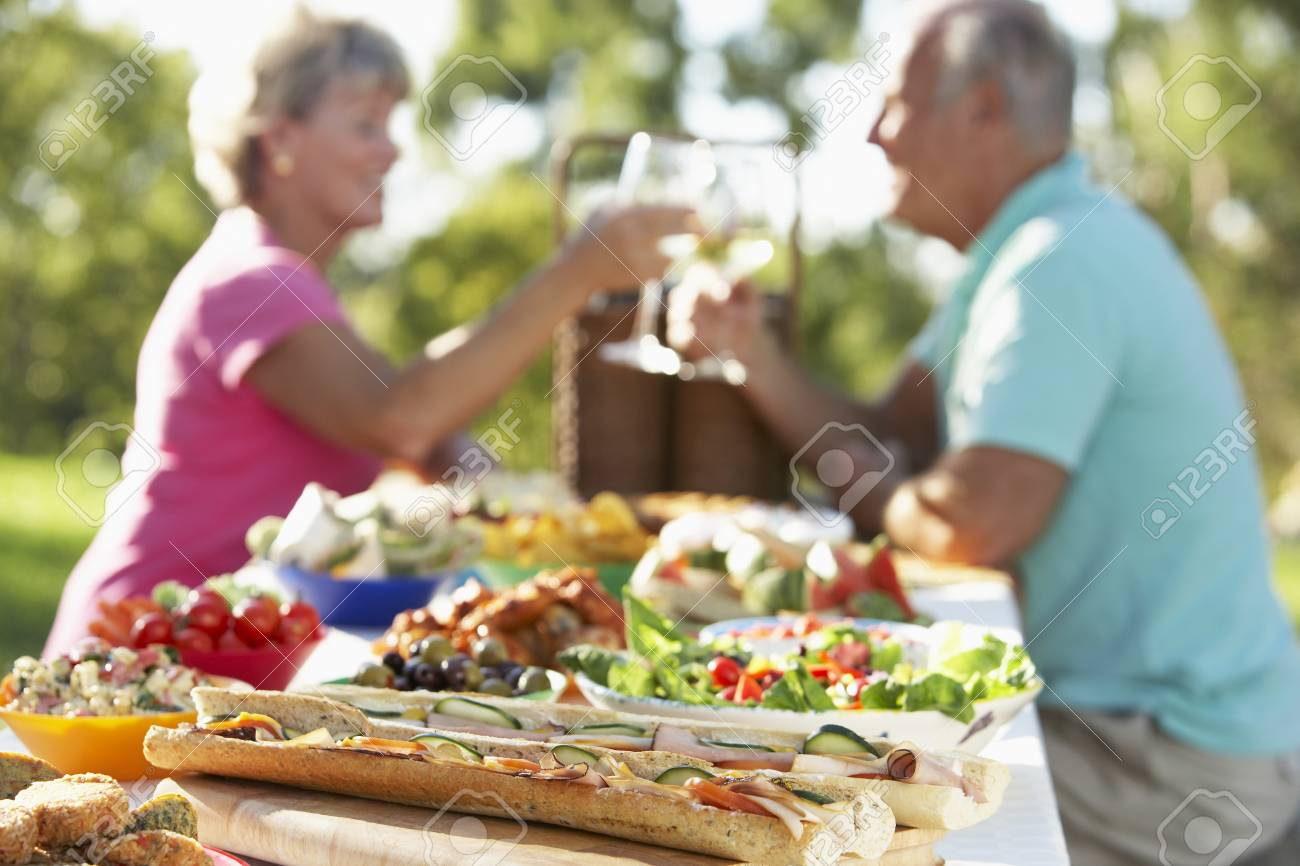 Couple Dining Al Fresco, Toasting Each Other Stock Photo - 4499294
