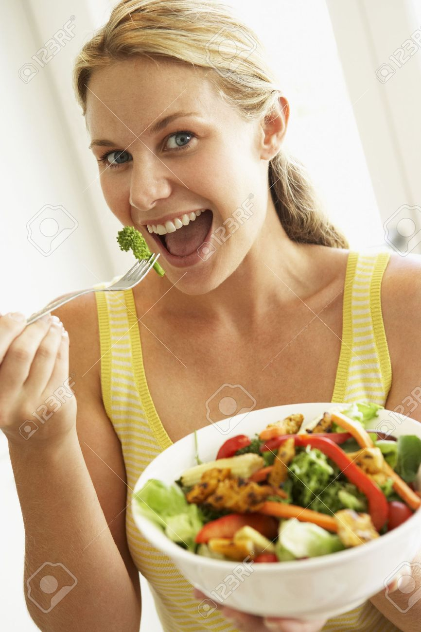 Mid Adult Woman Eating A Healthy Salad Stock Photo - 4499499
