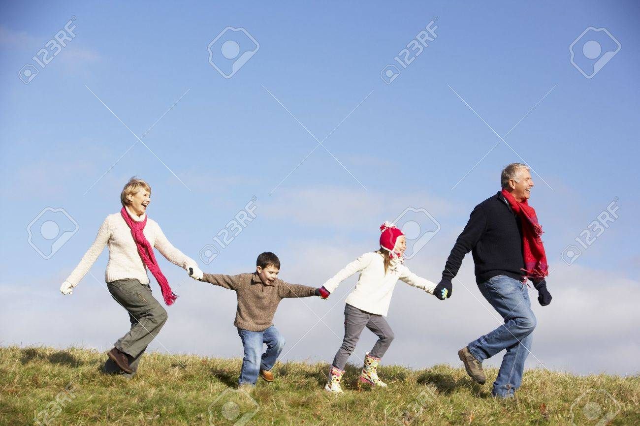 Grandparents And Grandchildren Running In The Park Stock Photo - 4506508