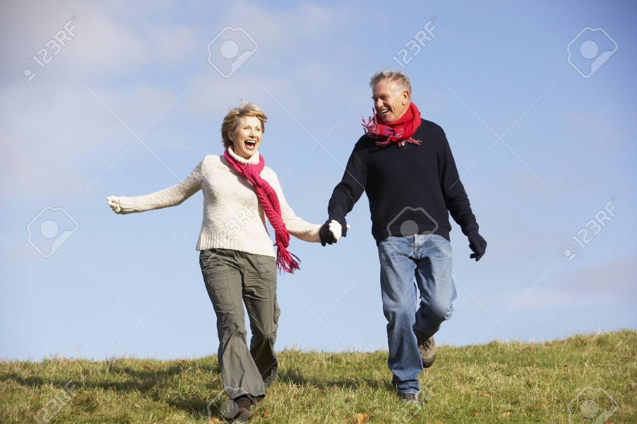 Senior Couple Running In The Park Stock Photo - 4506575