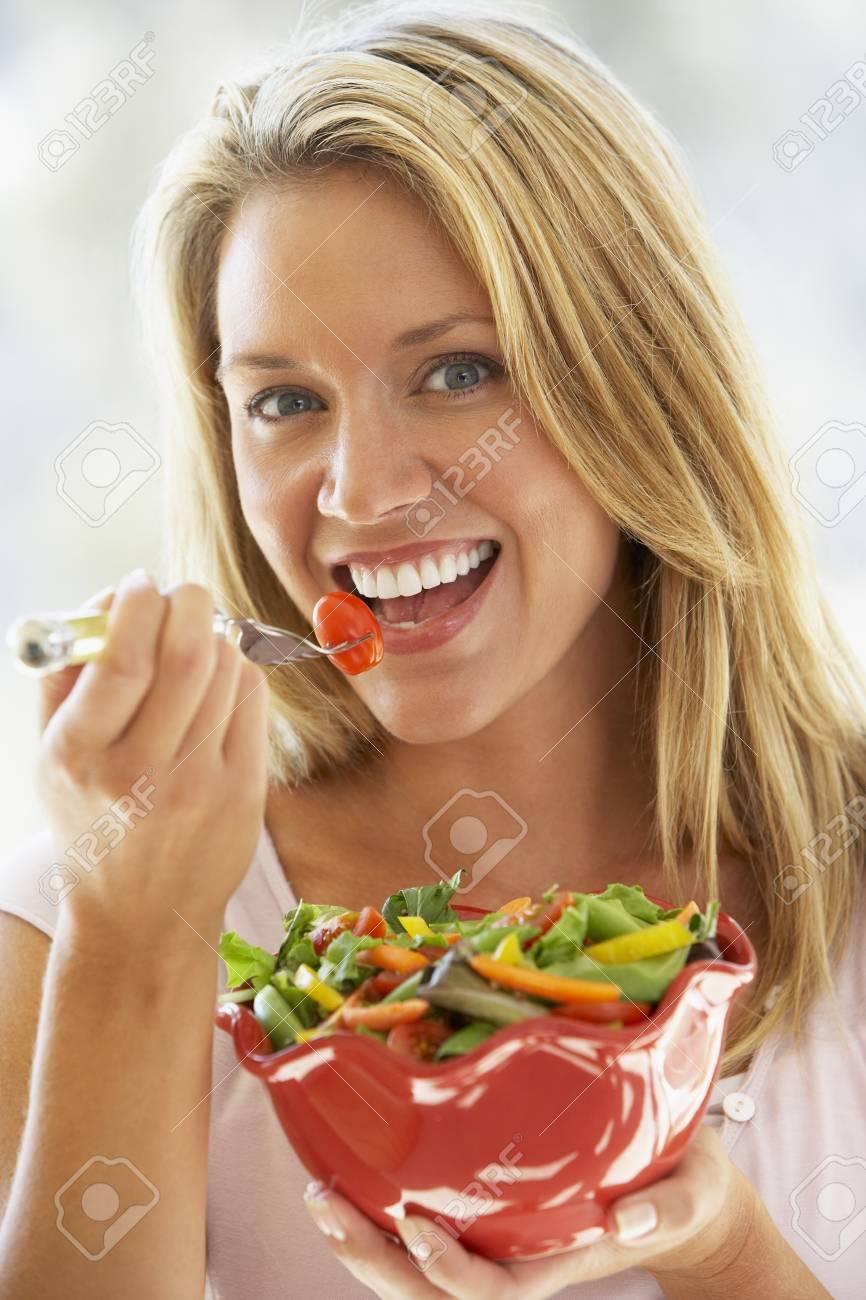 Young Woman Eating Fresh Salad Stock Photo - 4513885