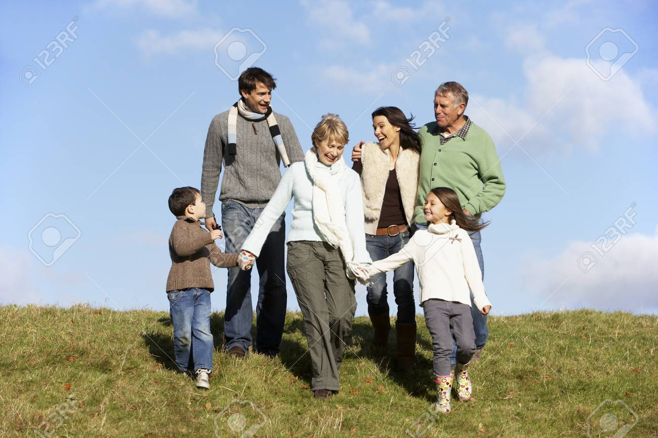 Family Walking In The Park Stock Photo - 4513920
