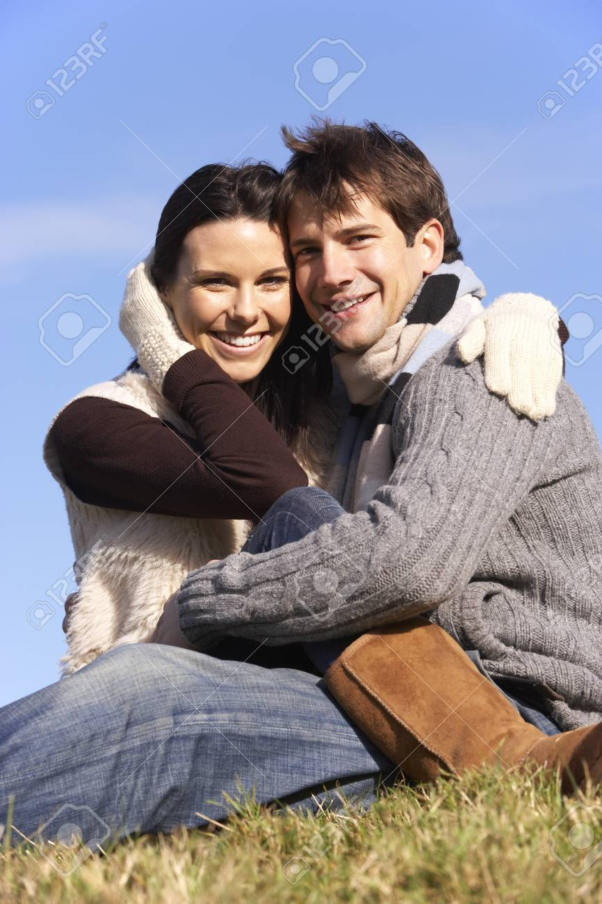 Couple Sitting In Park Together Stock Photo - 4513975