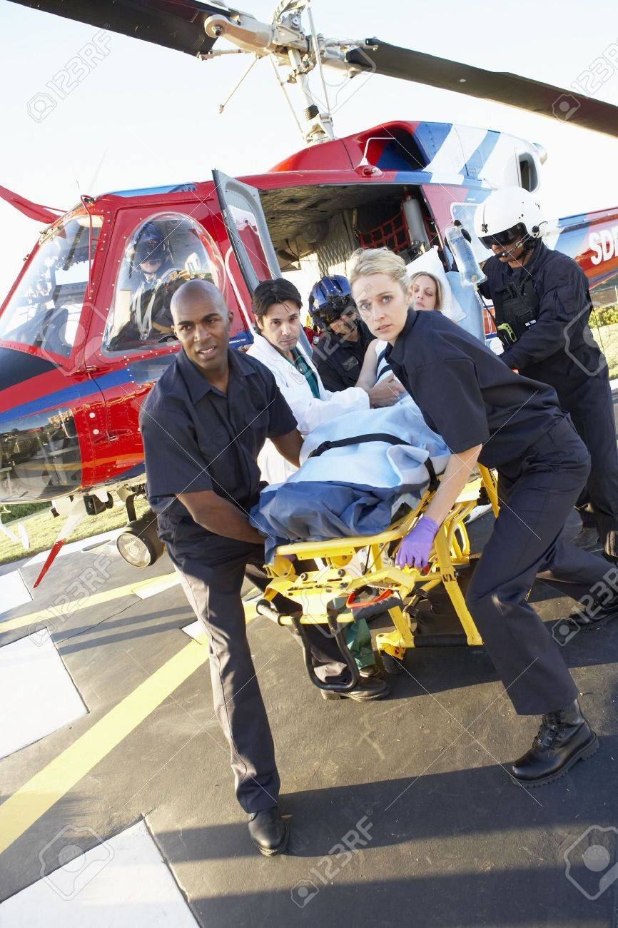 Paramedics unloading patient from Medevac Stock Photo - 4607510