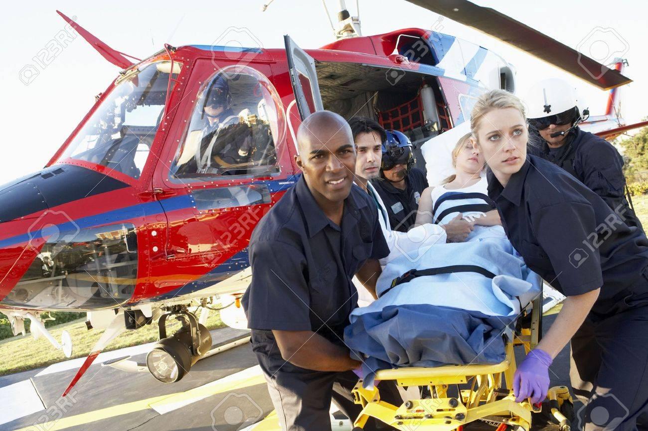 Paramedics unloading patient from Medevac - 4607756