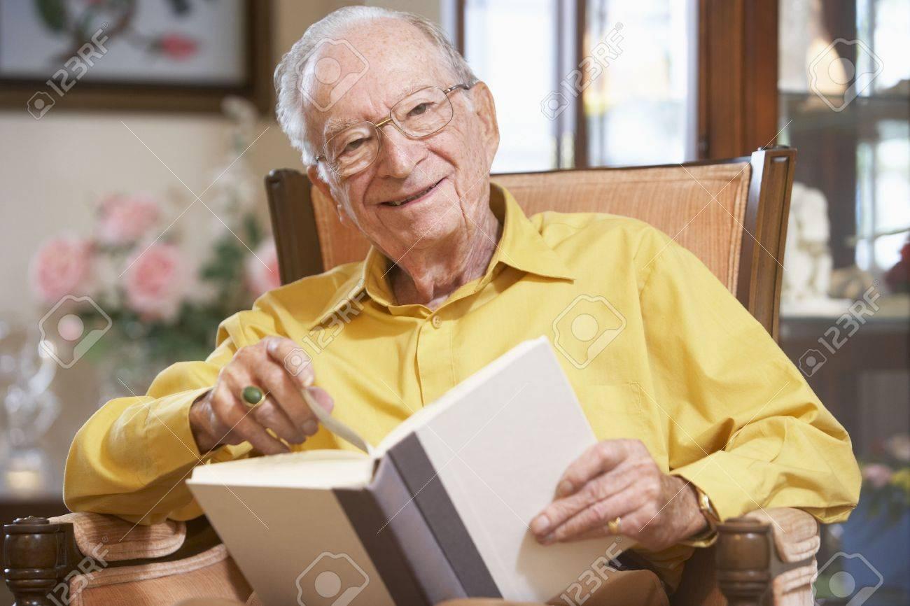 Senior man reading book Stock Photo - 4607673