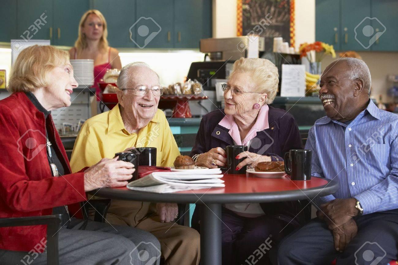 Senior adults having morning tea together Stock Photo - 4607371