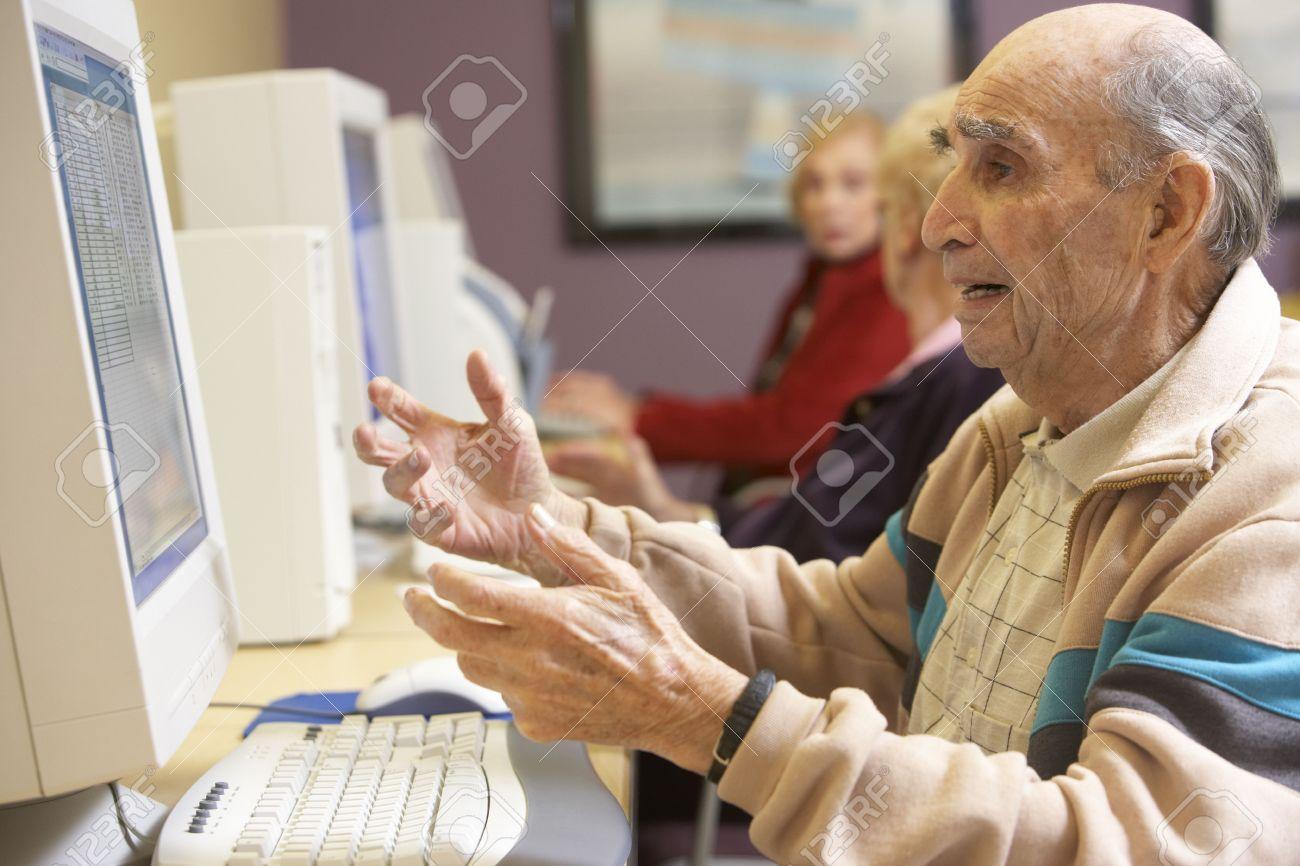 4607141-Senior-man-using-computer-Stock-
