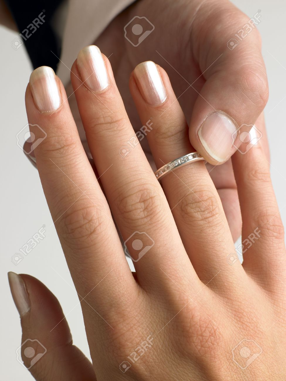 Man Putting Diamond Ring On Woman's Finger Stock Photo - 4638931
