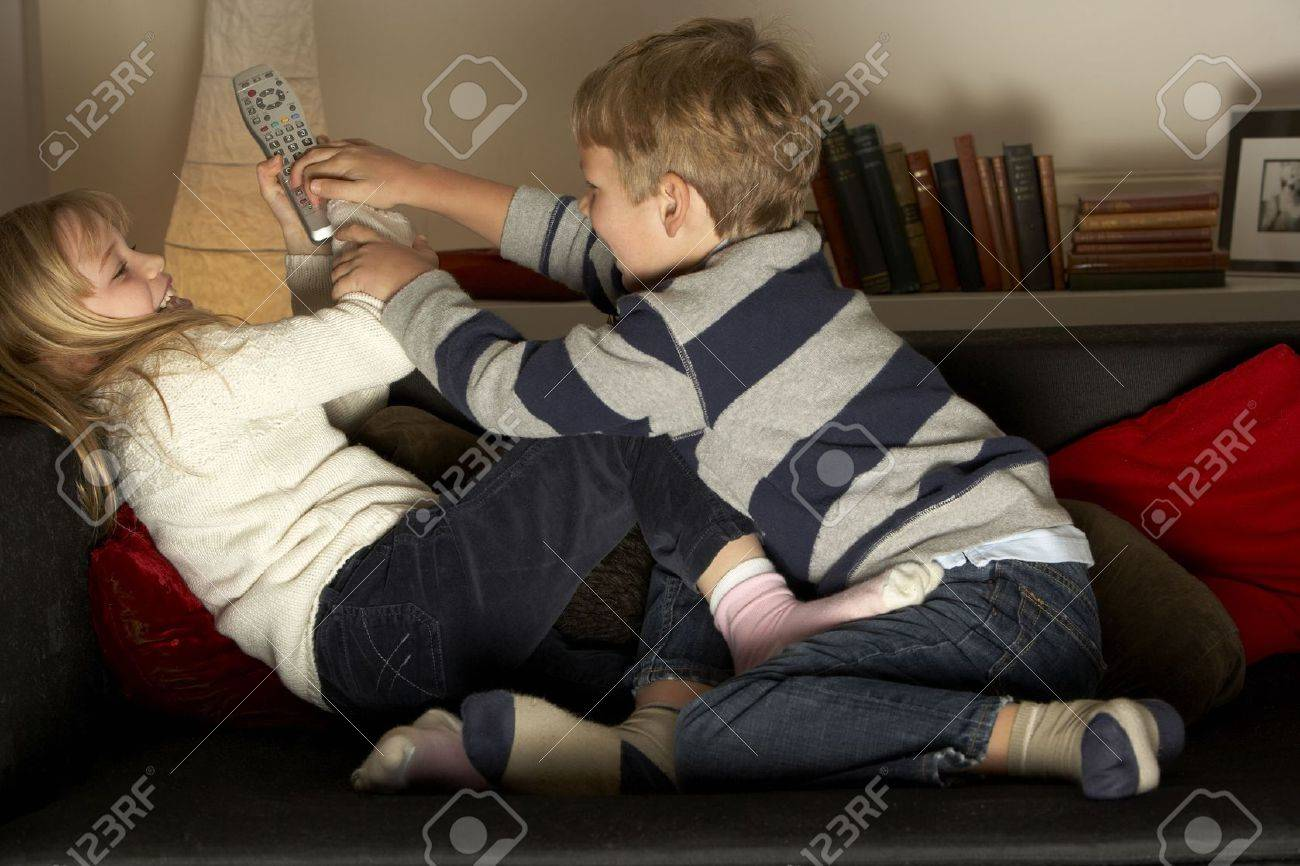 Brother And Sister Fighting Over Remote Control Stock Photo - 4644782