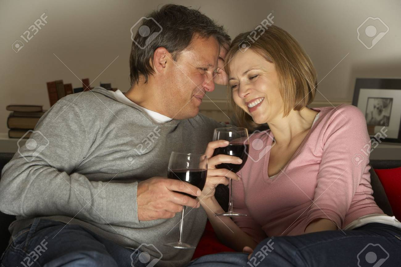 Couple Drinking Wine And Not Watching Television Stock Photo - 4644785