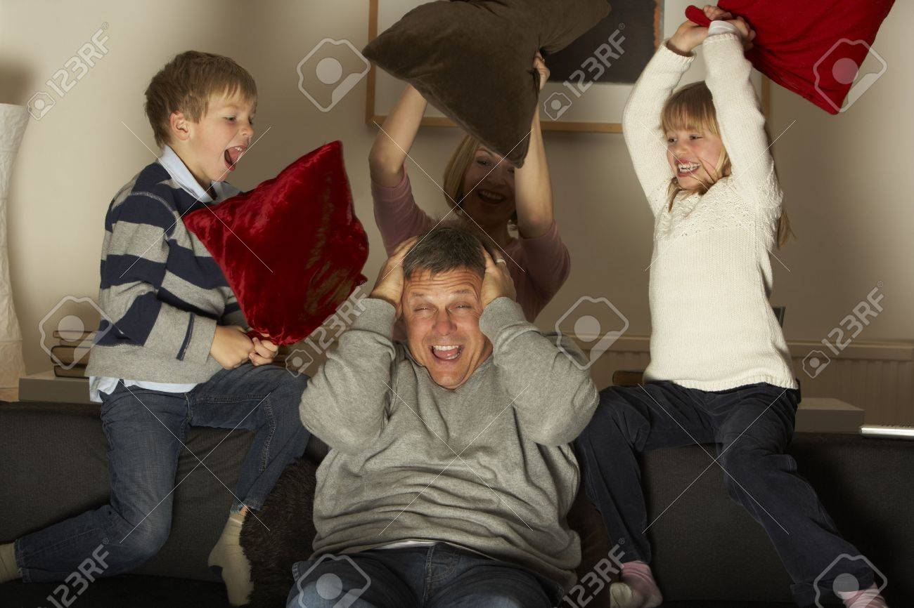Parents And Two Children In Pillow Fight Stock Photo - 4644783