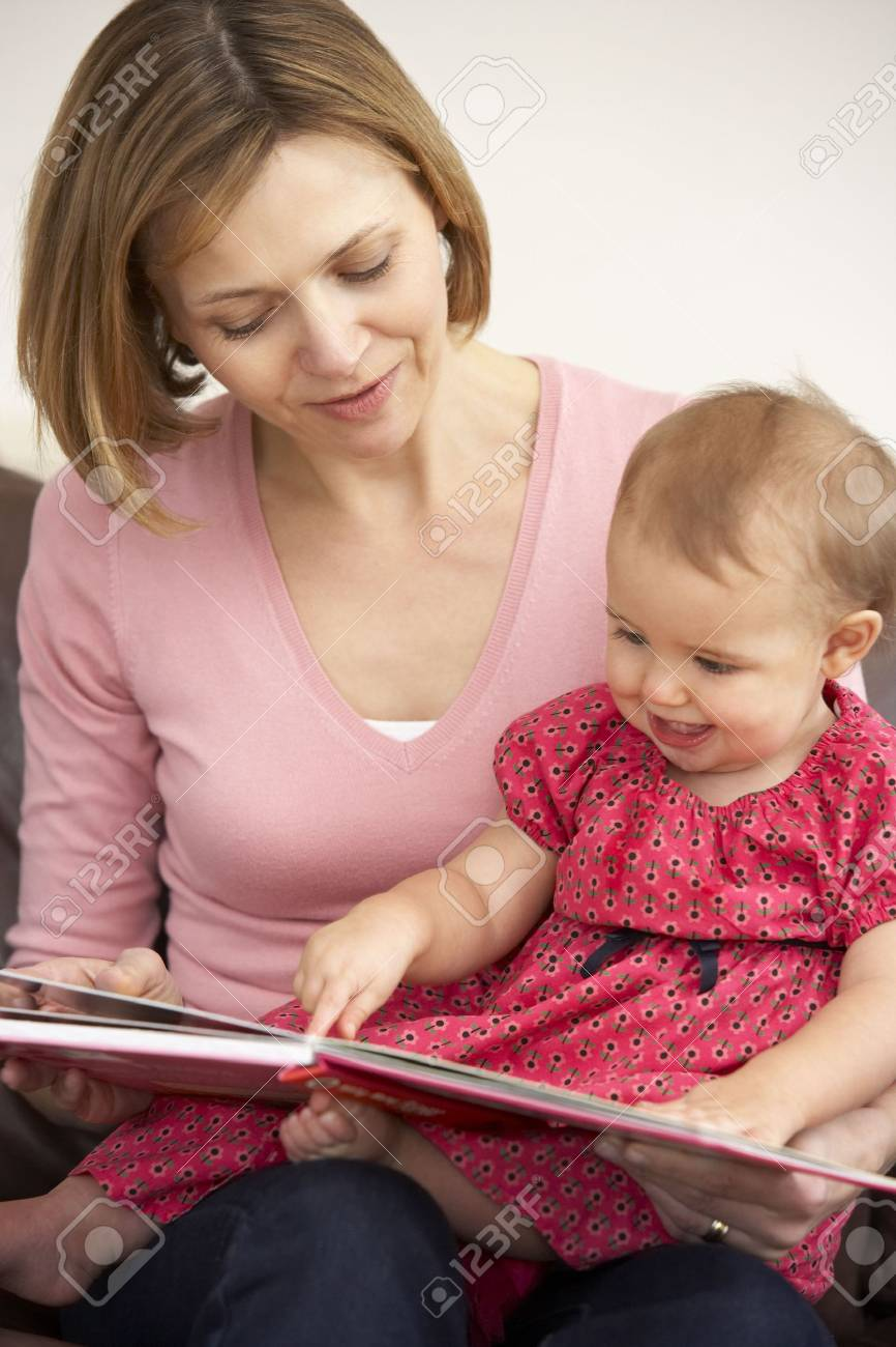 Mother And Baby Daughter Reading Book Stock Photo - 4645043