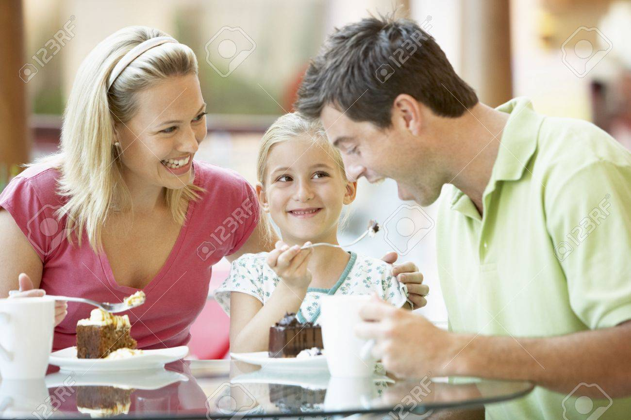 Family Having Lunch Together At The Mall Stock Photo - 4645117