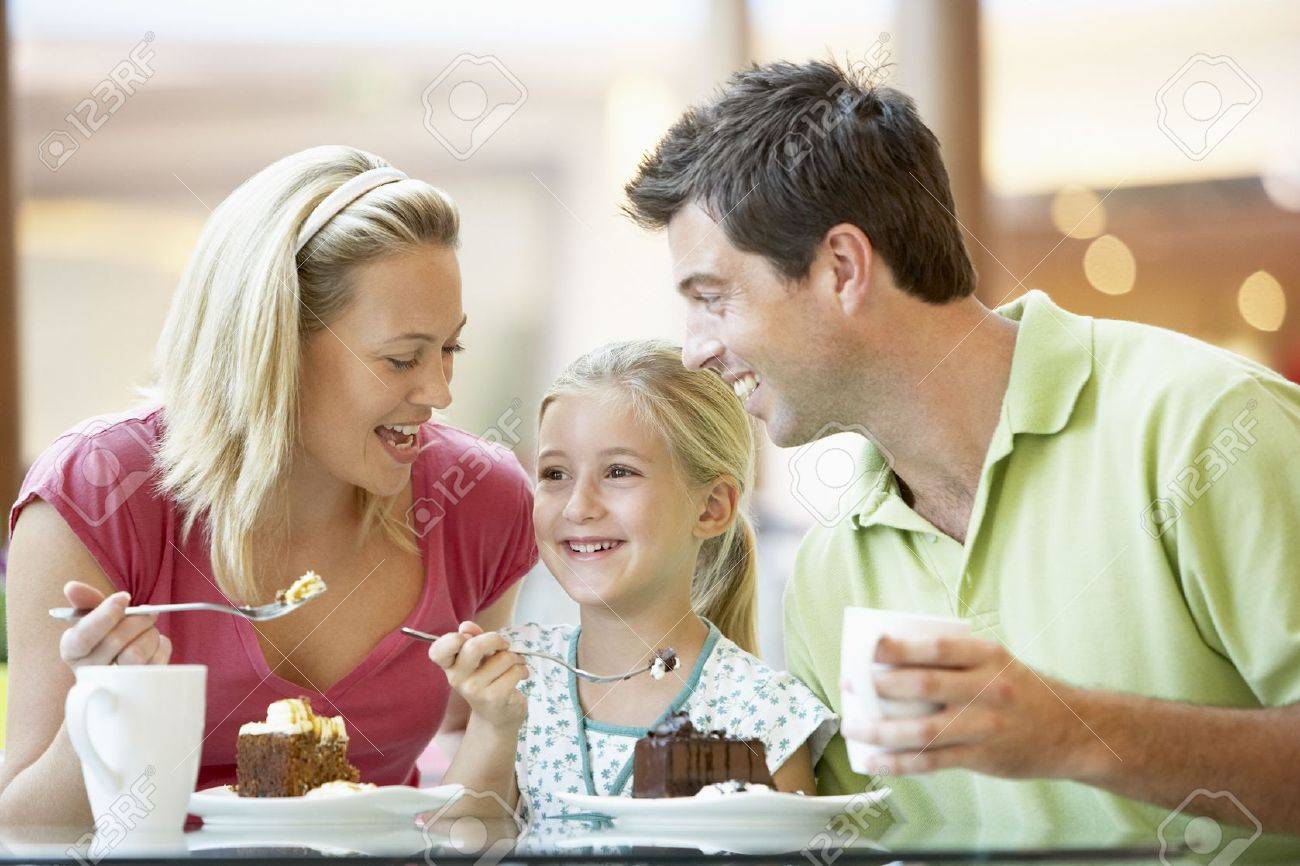 Family Having Lunch Together At The Mall Stock Photo - 4645106