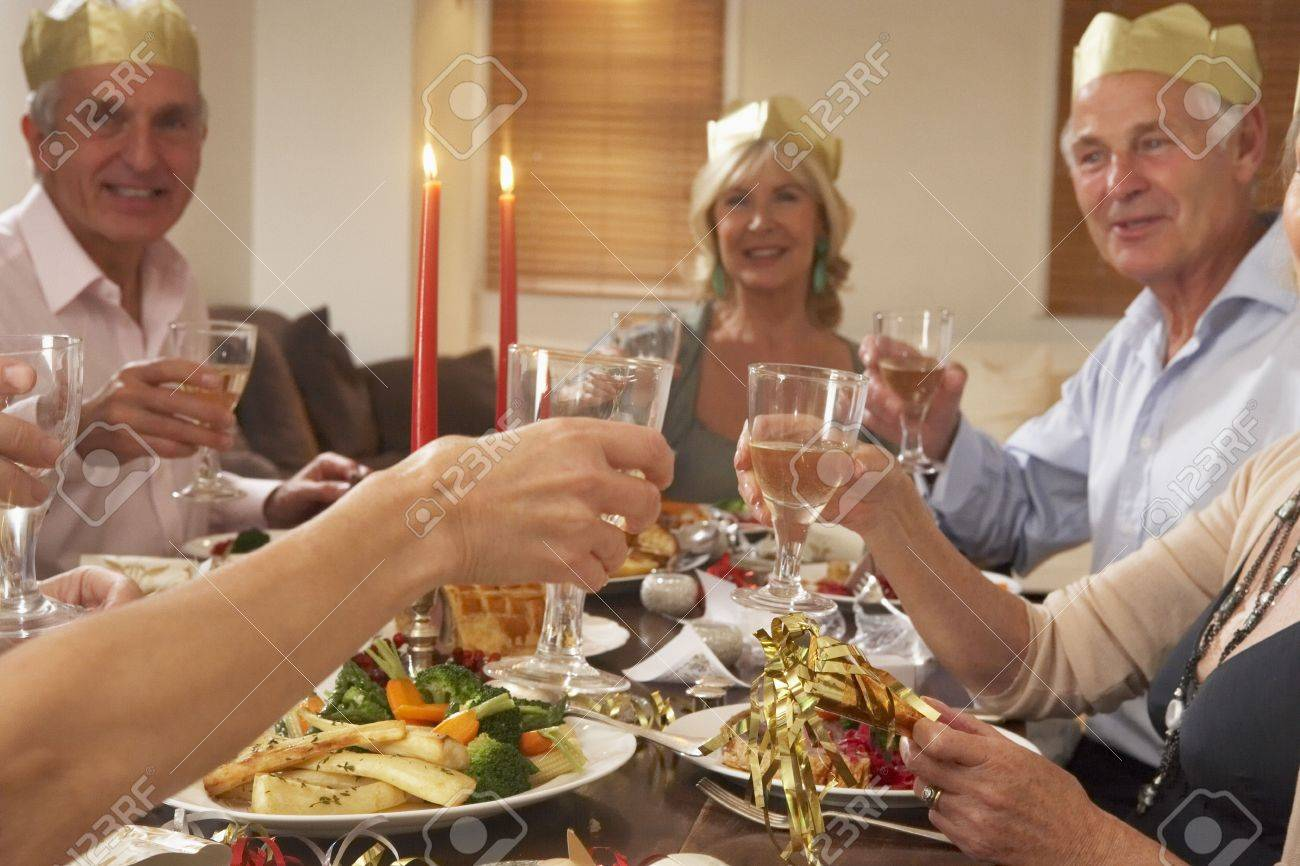 Friends Wearing Party Hats At A Dinner Party Stock Photo - 4646077