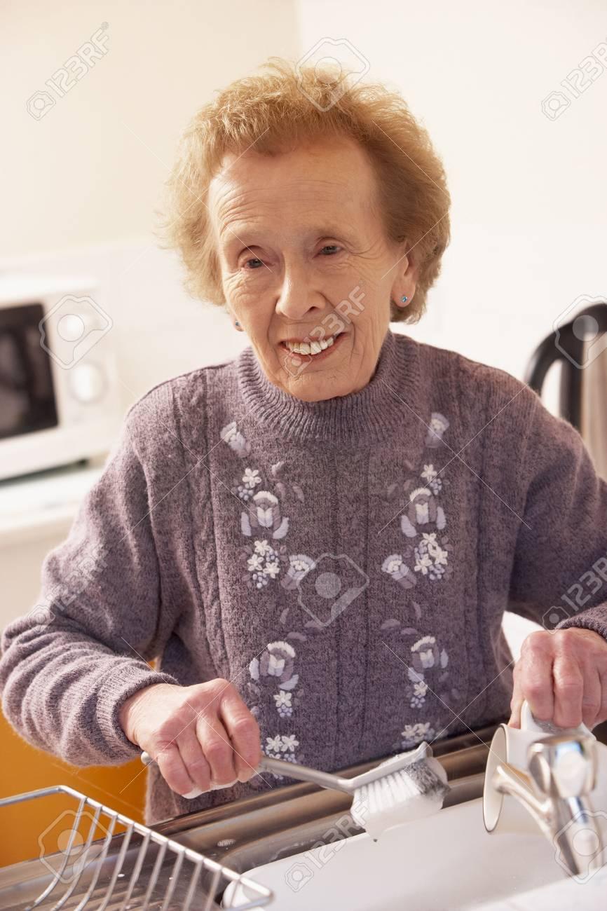 Senior Woman Washing Up At Sink Stock Photo - 5041938