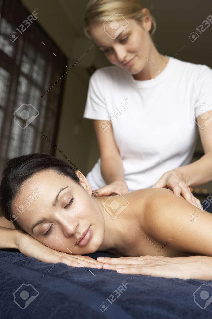 Young Woman Enjoying Massage Stock Photo - 5041512