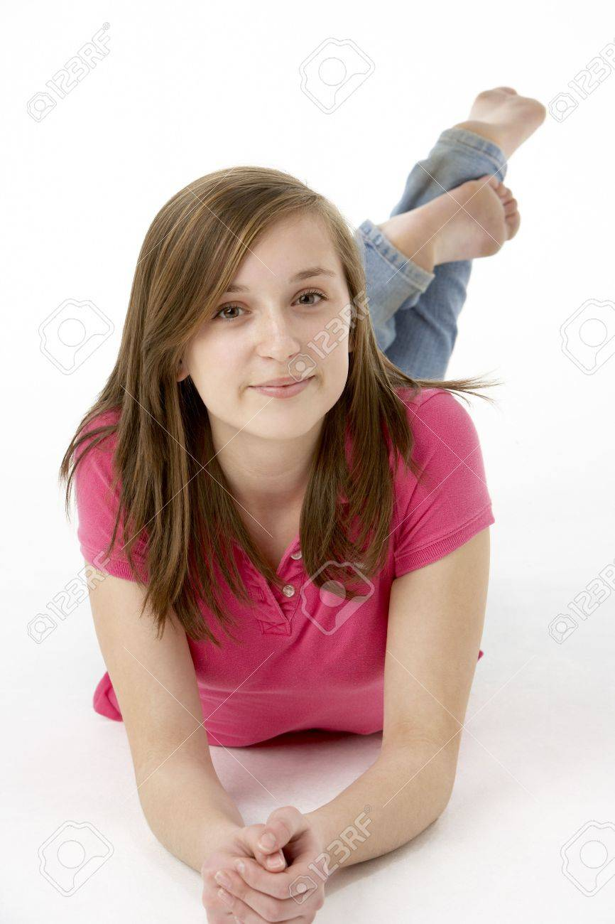 Teenage Girl Laying On Stomach Stock Photo - 5517065