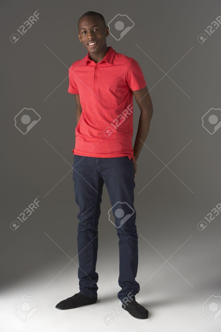 Teenage Boy Standing In Studio Stock Photo - 5515730