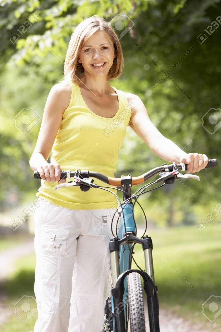 Woman riding bike in countryside Stock Photo - 5632858