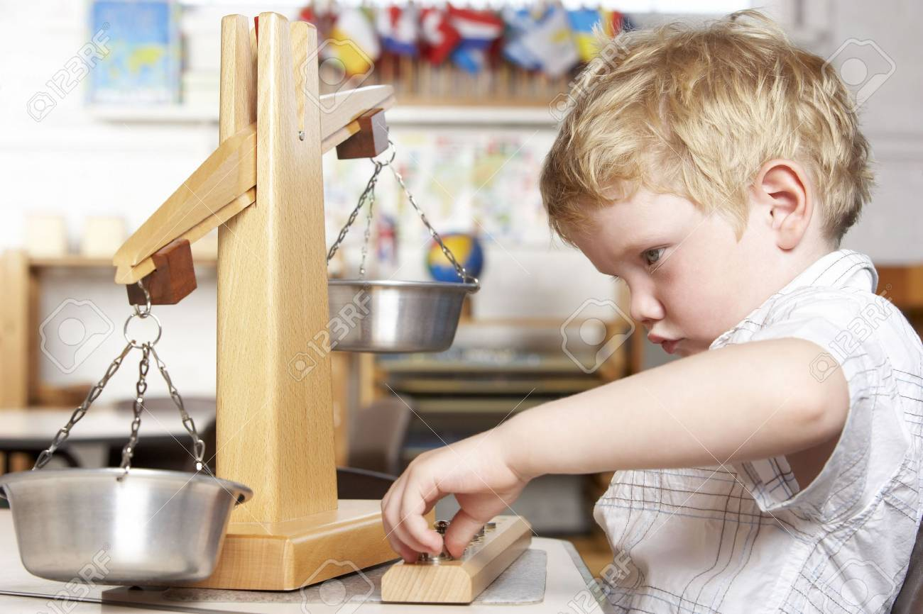 Young Boy Playing at Montessori/Pre-School Stock Photo - 5633193