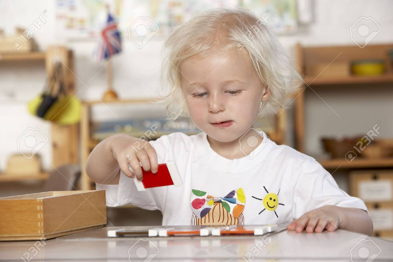 Adult Helping Young Children at Montessori/Pre-School Stock Photo - 5633335