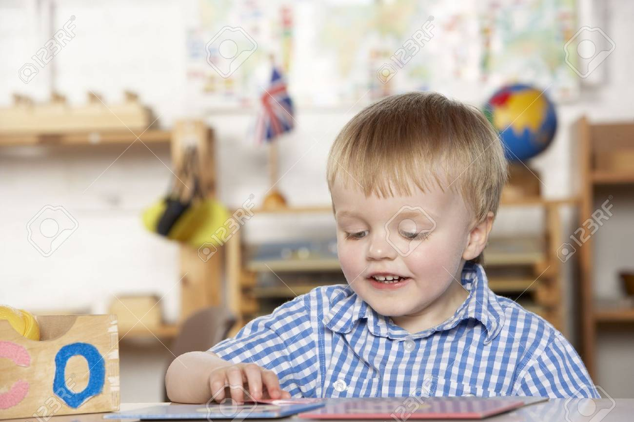 Young Girl Playing at Montessori/Pre-School Stock Photo - 5633214