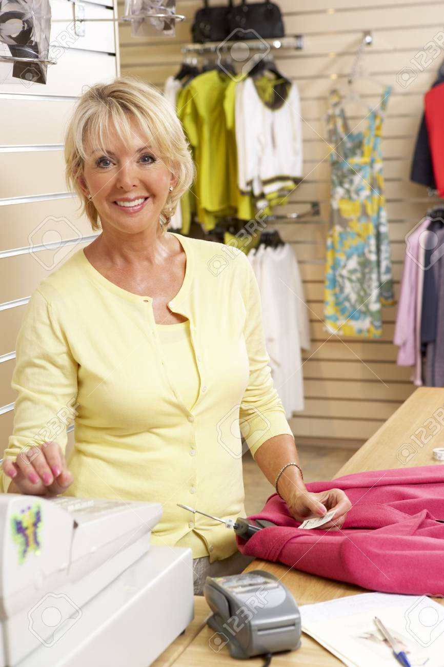 Female sales assistant in clothing store Stock Photo - 5633640