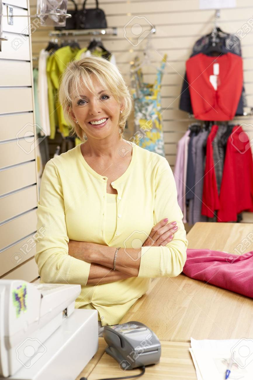 Female sales assistant in clothing store Stock Photo - 5633229