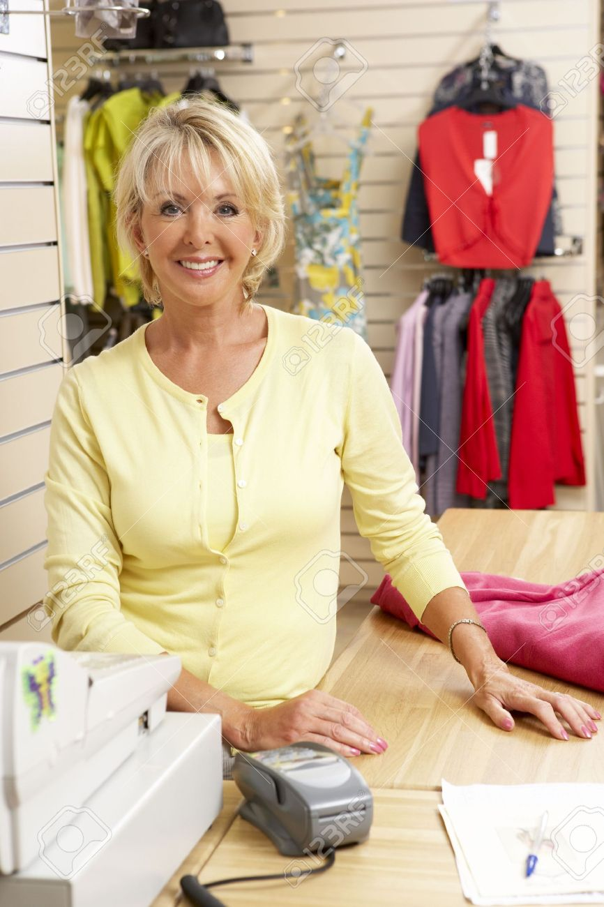 female s assistant in clothing store stock photo picture and female s assistant in clothing store stock photo 5633351