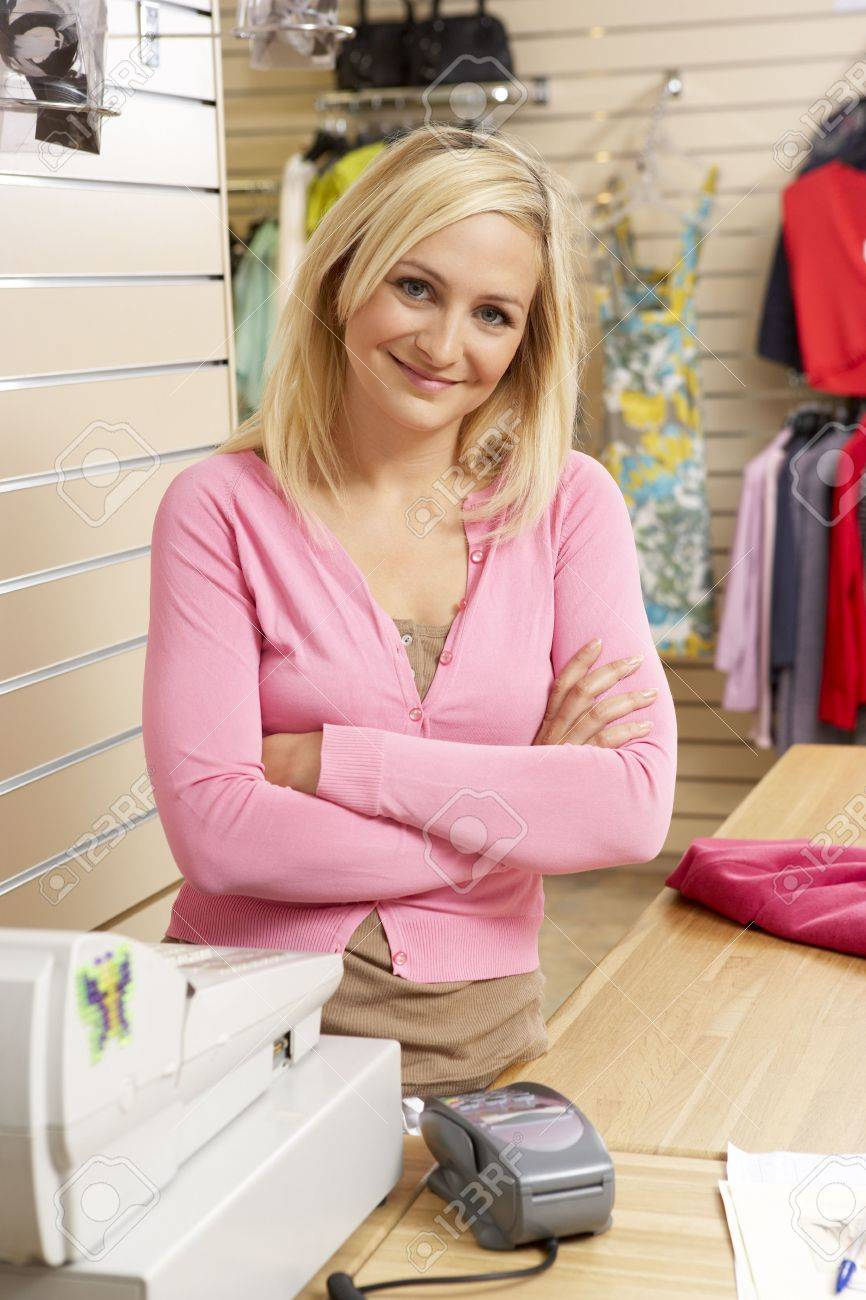 female s assistant in clothing store stock photo picture and female s assistant in clothing store stock photo 5633390