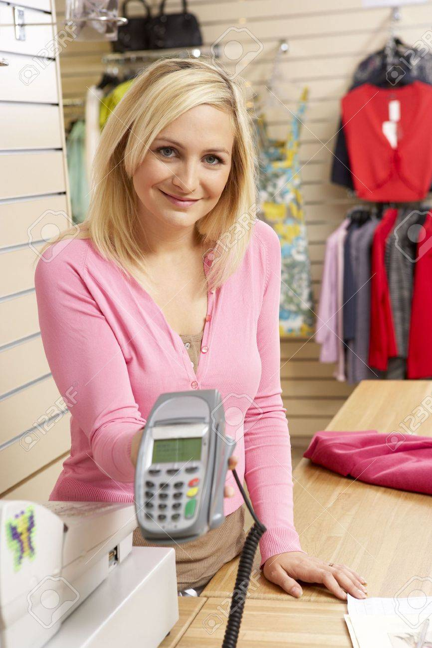 female s assistant in clothing store stock photo picture and female s assistant in clothing store stock photo 5633356