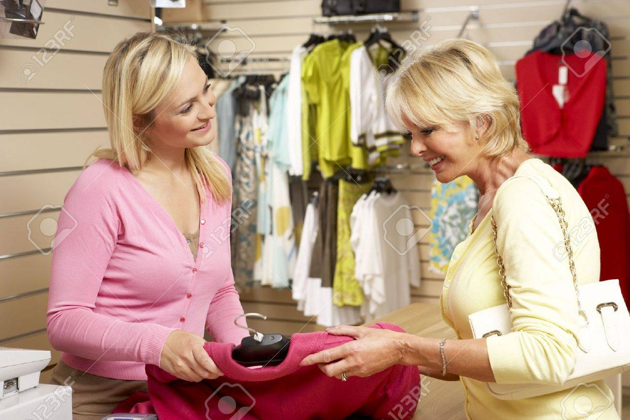 s assistant customer in clothing store stock photo s assistant customer in clothing store stock photo 5633380