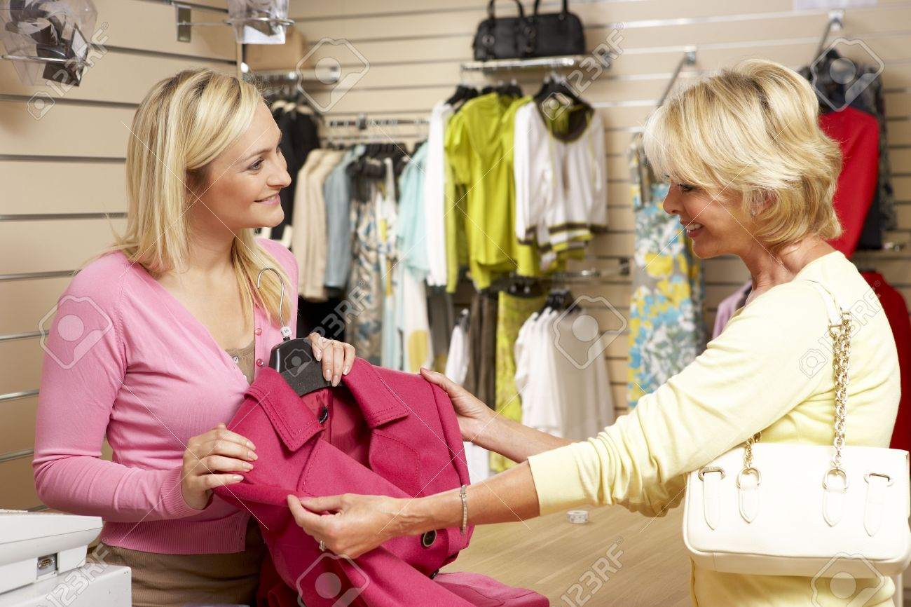 s assistant customer in clothing store stock photo s assistant customer in clothing store stock photo 5633478