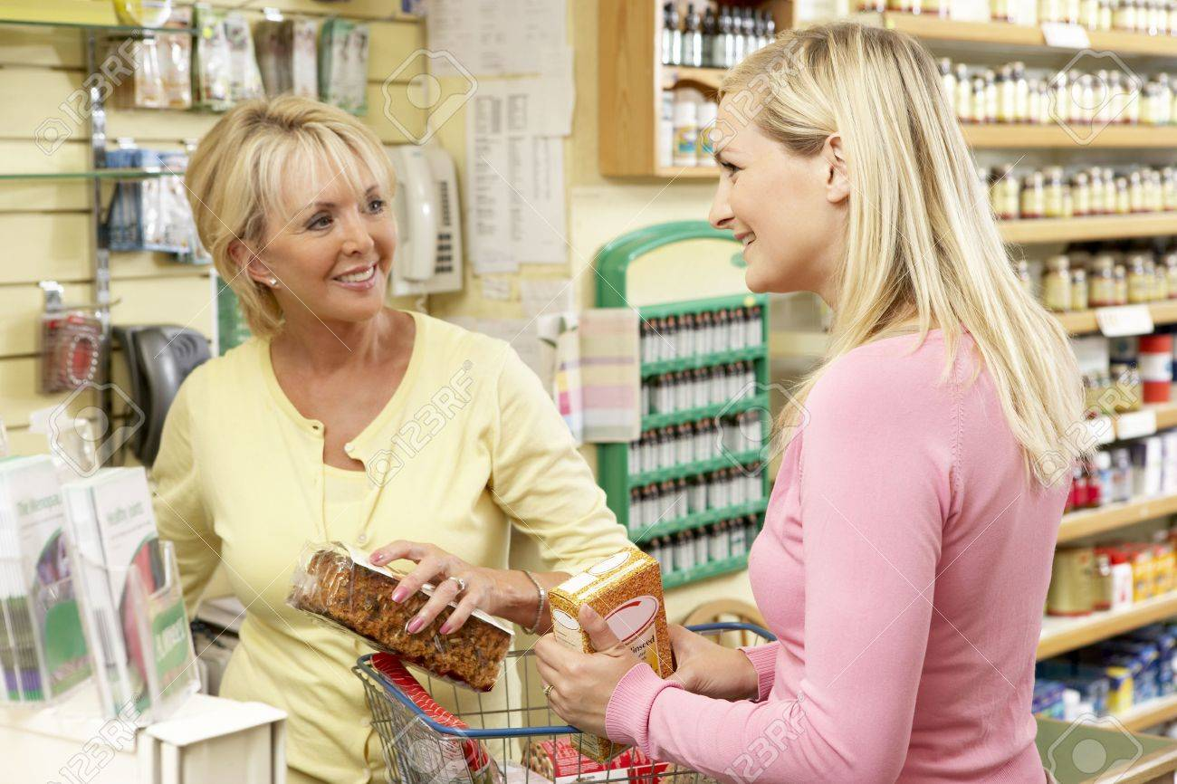 s assistant customer in health food store stock photo s assistant customer in health food store stock photo 5633455