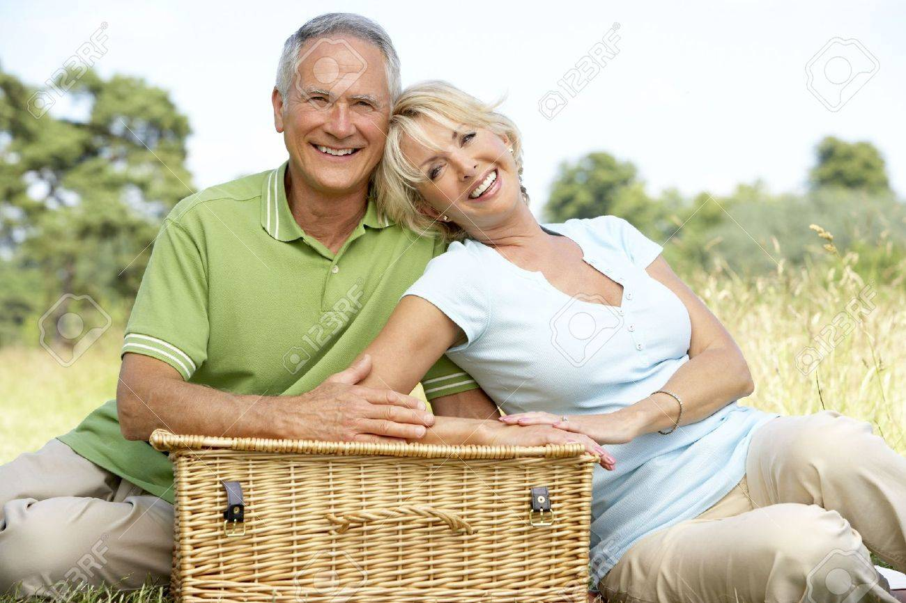 Mature couple having picnic in countryside Stock Photo - 5633595