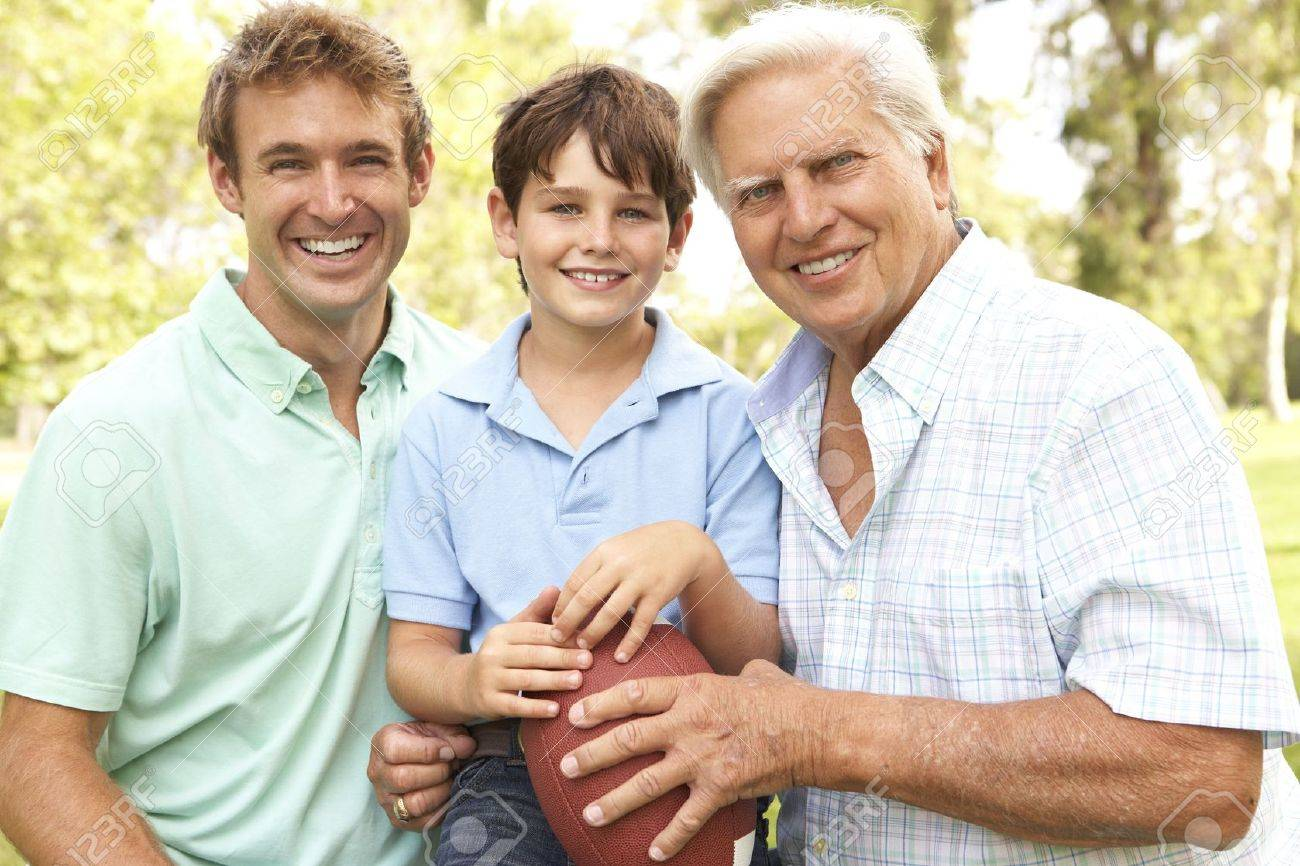 Grandfather With Father And Son Playing American Football Together Stock Photo - 6142945