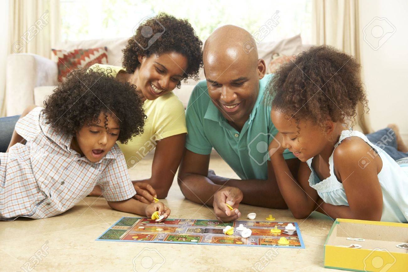 Family Playing Board Game At Home Stock Photo - 6143200