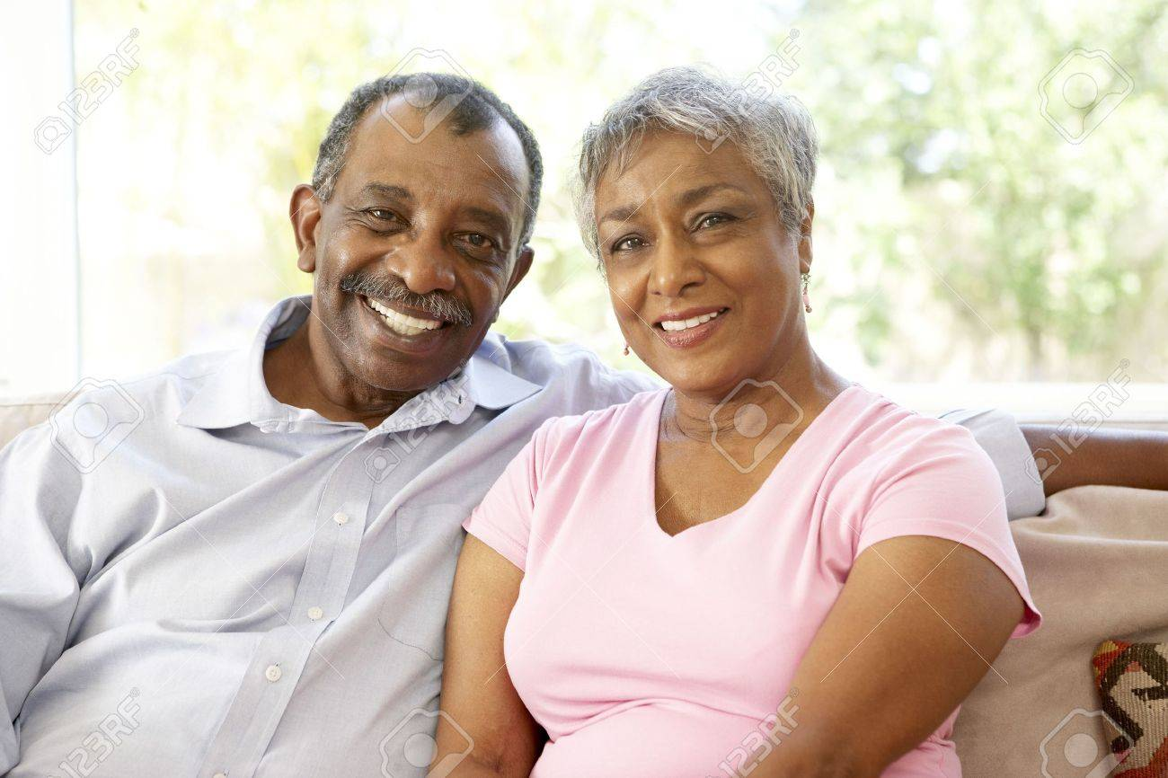 Senior Couple Relaxing At Home Together Stock Photo - 6143294