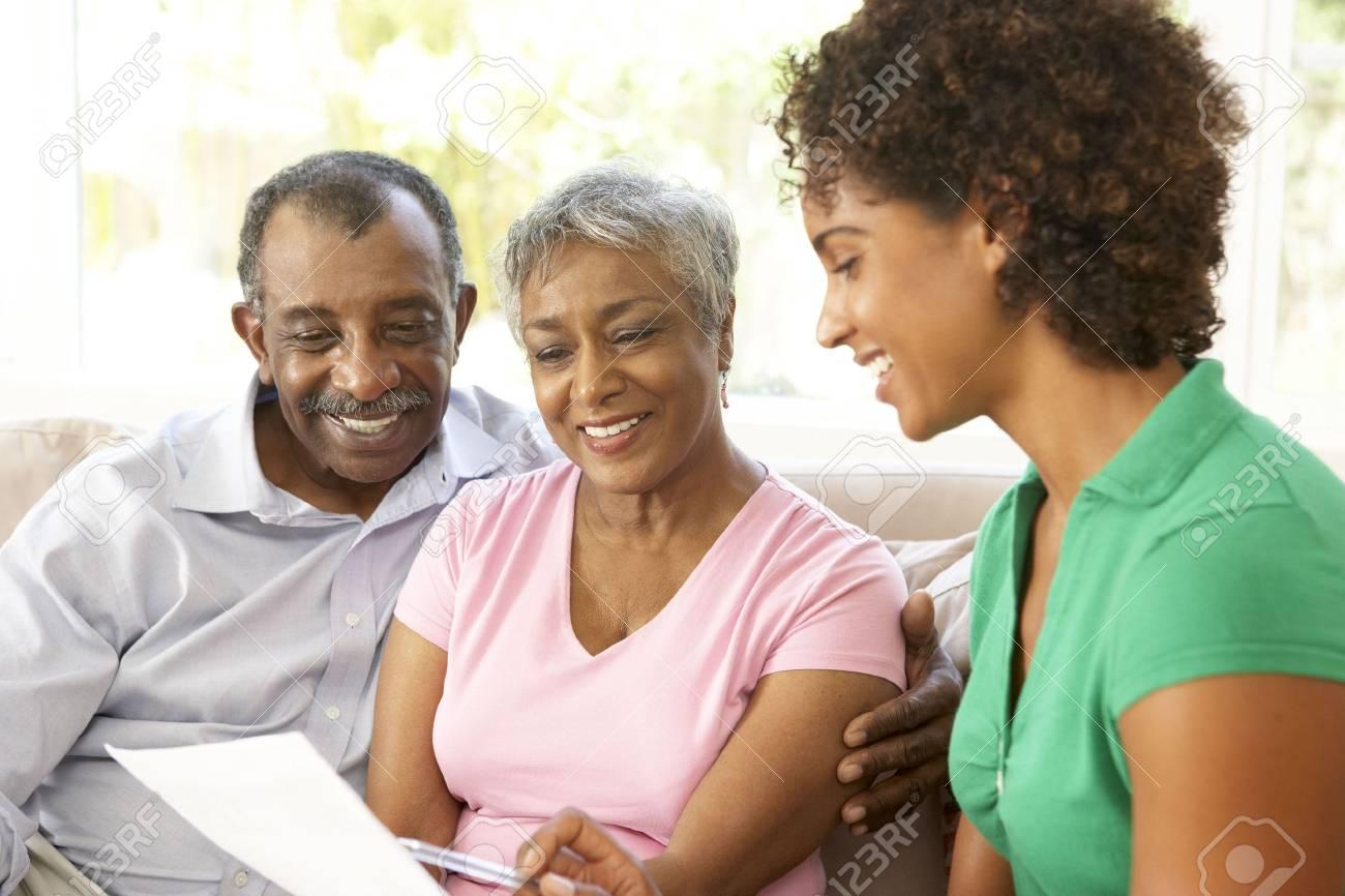 Senior Couple Talking To Financial Advisor At Home Stock Photo - 6142965