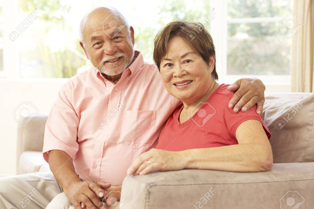 Senior Couple Relaxing At Home Together Stock Photo - 6128033