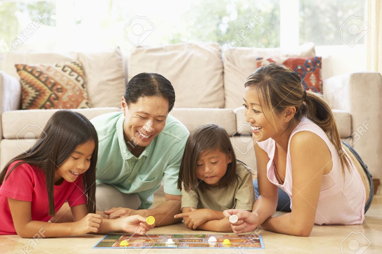 Family Playing Board Game At Home Stock Photo - 6128234