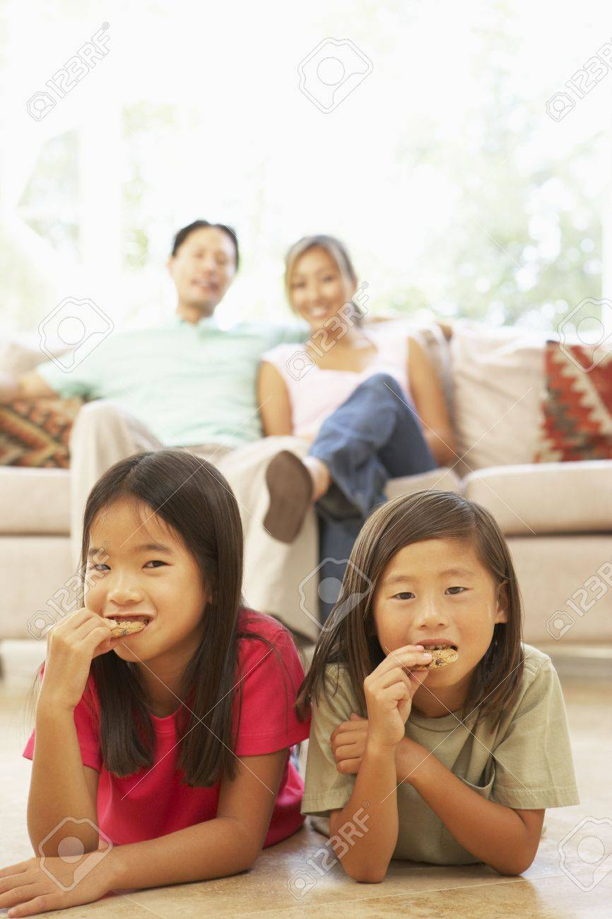 Two Girls Eating Cookies At Home Stock Photo - 6128058