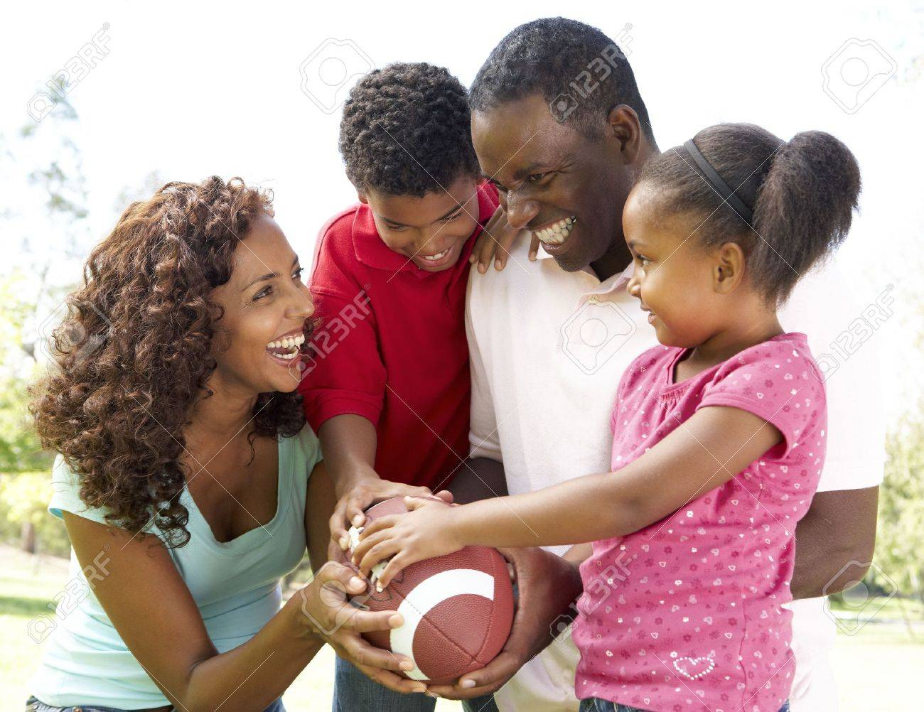 Family In Park With American Football Stock Photo - 6456300