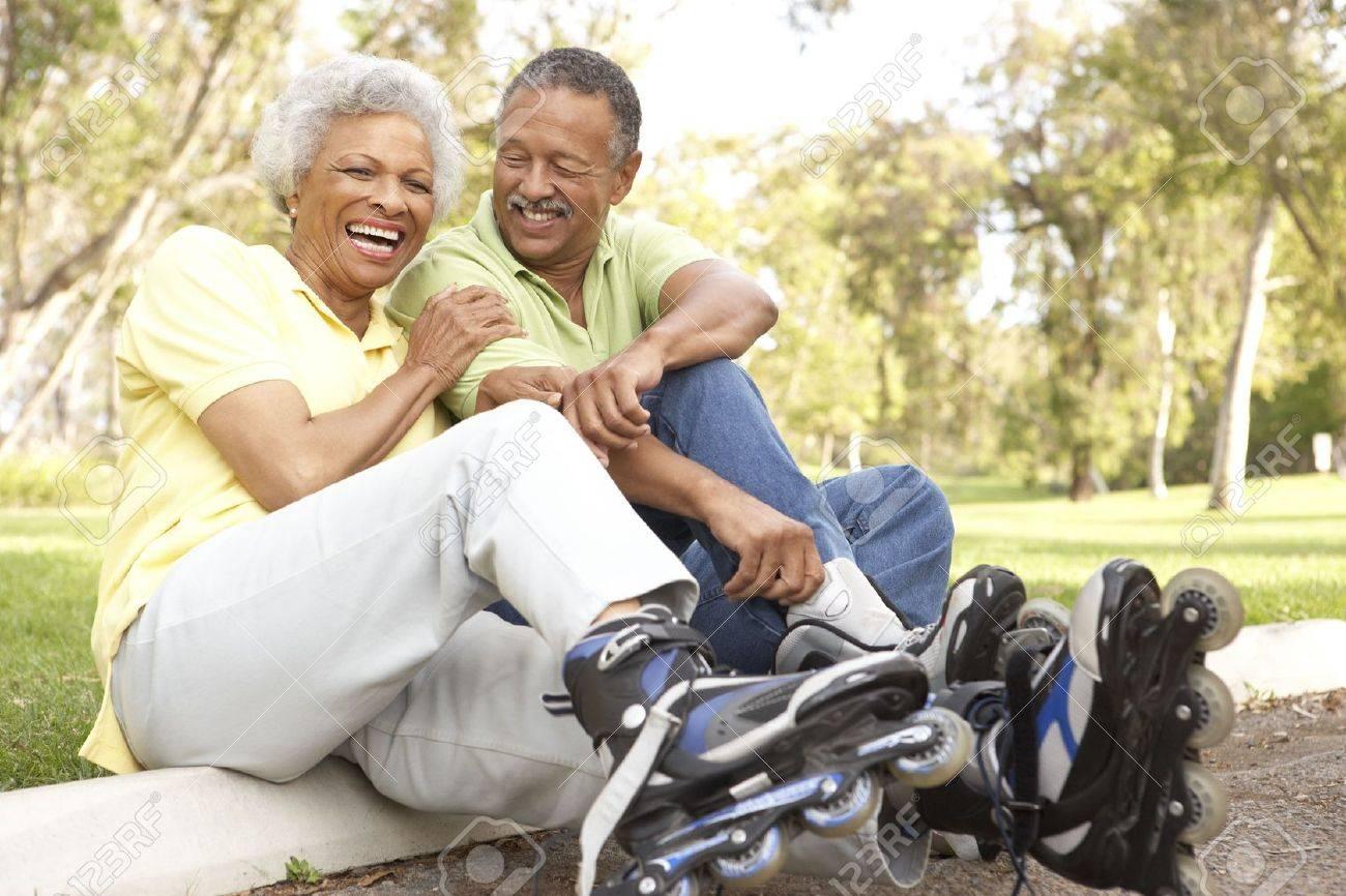 Senior Couple Putting On In Line Skates In Park Stock Photo - 6456550