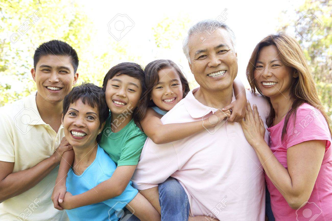 Portrait Of Extended Family Group In Park Stock Photo - 6456318