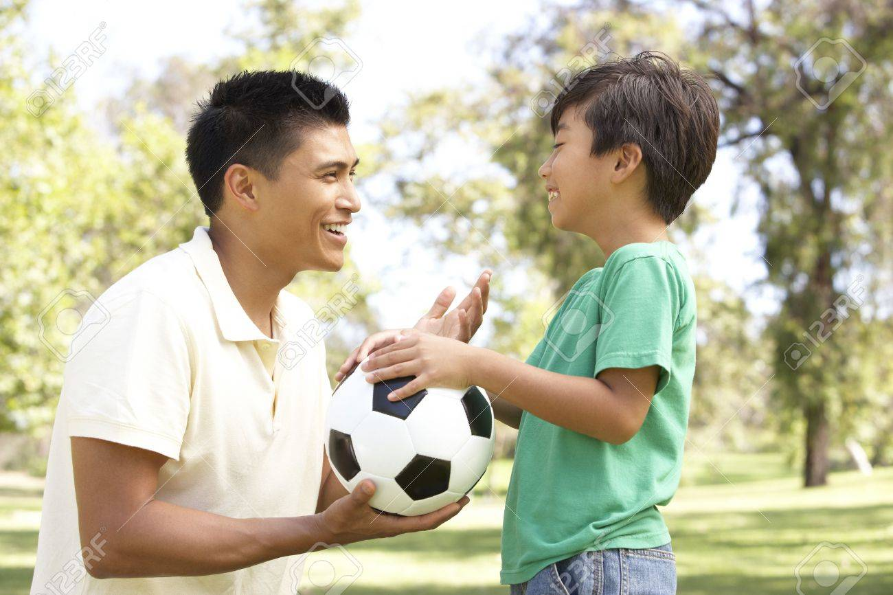 Father And Son In Park With Football Stock Photo - 6456345