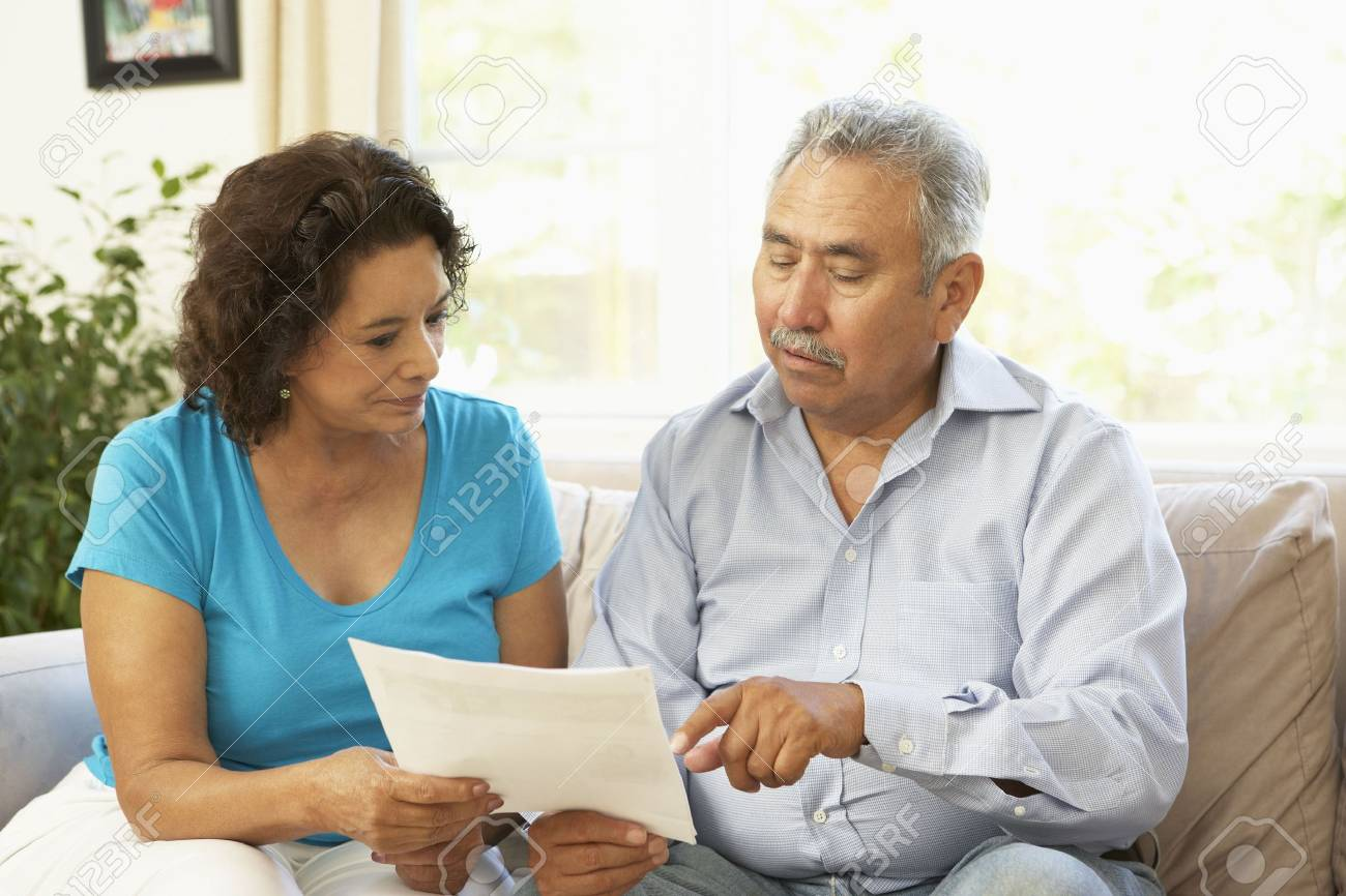 Senior Couple Studying Financial Document At Home Stock Photo - 6456412