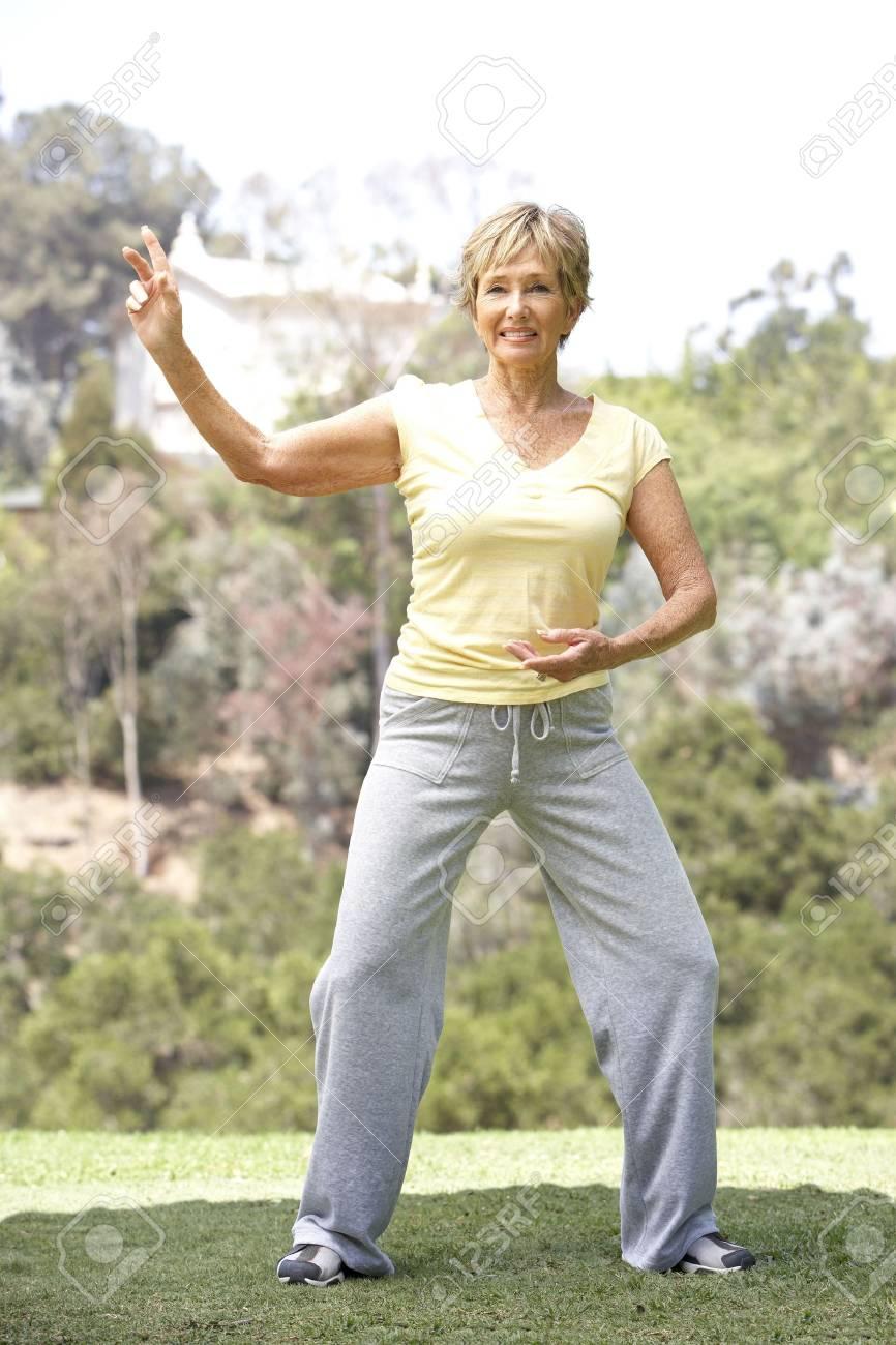 Senior Woman Exercising In Park Stock Photo - 6452737
